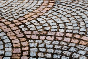 Pros and Cons of Stamped Concrete vs Pavers